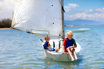 Kids on a sail boat